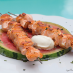Grilled watermelon with salmon skewers
