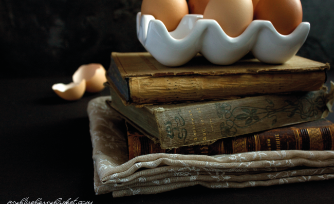 photo of eggs on a pile of books